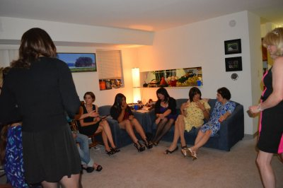 A roomful of girls get to know each other over drinks and snacks.