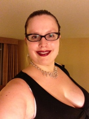 Beth dresses in a black top and skirt, black wedge sandals, silver jewelry, and Mulberry Forest Glossy Lip Stain to head down for her first night of networking at SCC.