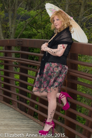 """I love my new parasol and tattoos. Parasol, pink pumps, and patina bridge make me nostalgic."""