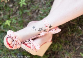 Check out her pretty, pink shoes and ankle tattoos.