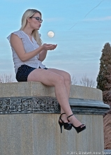 Miss February enchants the moon.