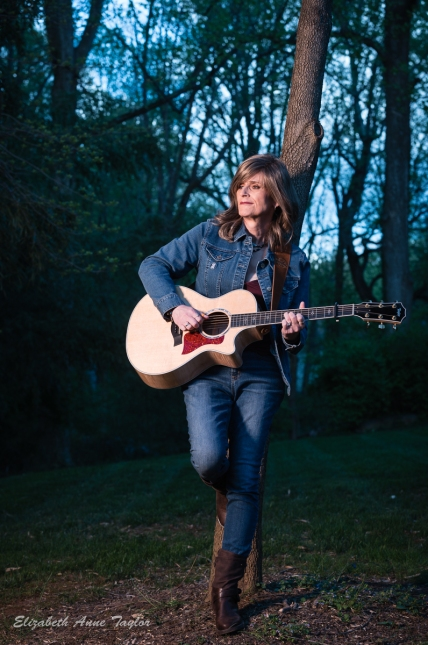 Lauren strums guitar