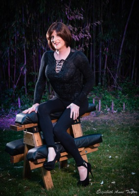 Image of Allison in front of purple bamboo on bench