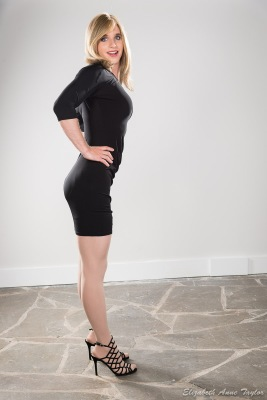 Connie arches back in black dress