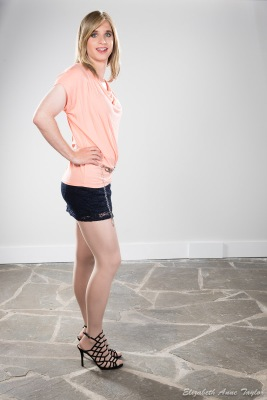 Connie wears light coral top with black skirt