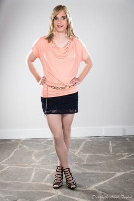 Connie wear coral top and black skirt