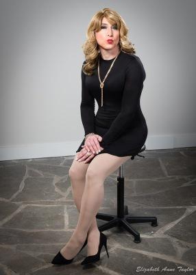 Stacie Stevens seated in black dress