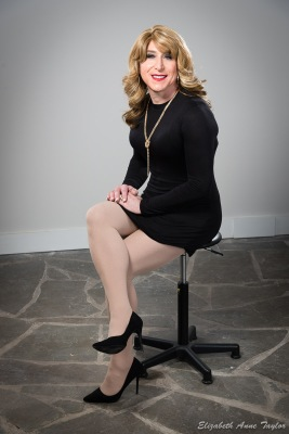 Stacie Stevens seated in black dress