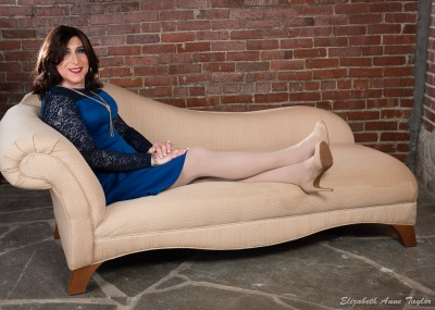 Stacie Stevens reclines on fainting couch